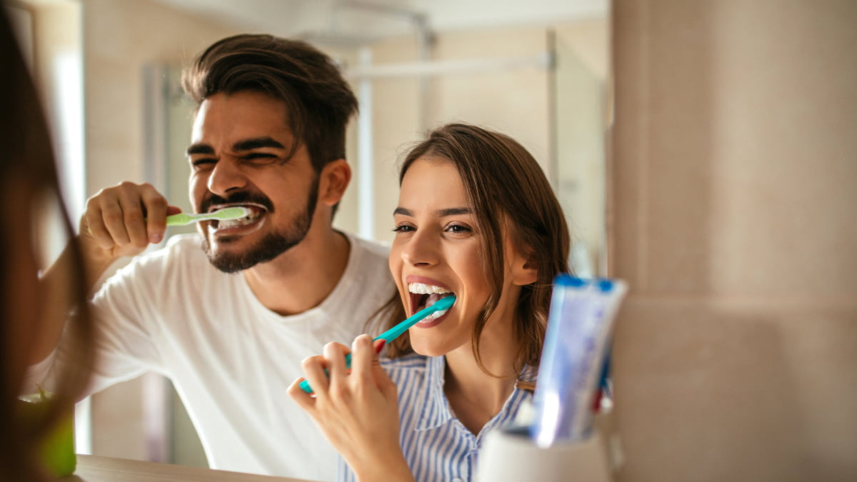 Centennial Dentist two people brushing their teeth to keep them healthy